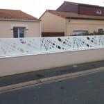 Muret  avec  clôture avec couvertines
